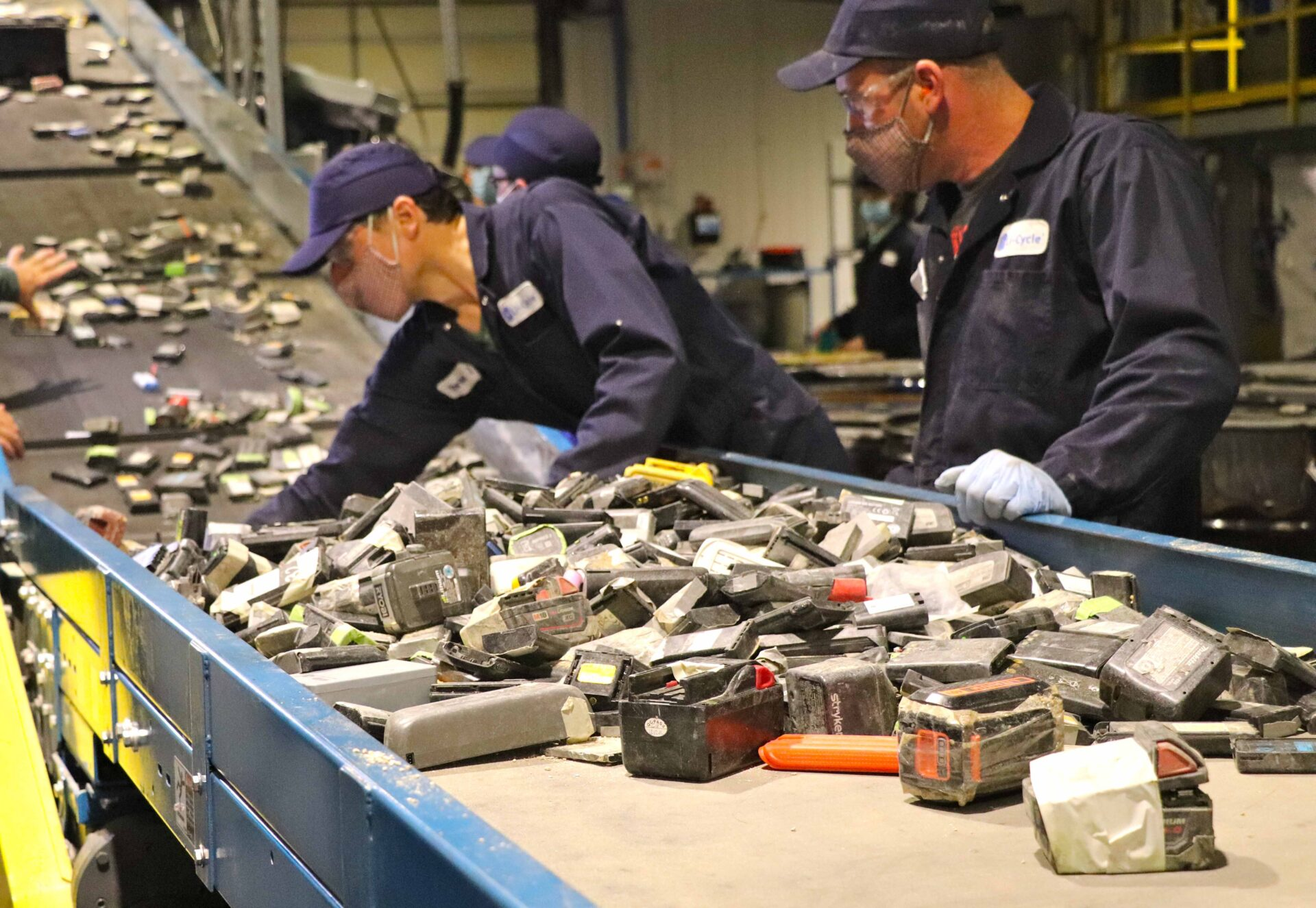 Lithium-ion batteries being fed to the shredder 1